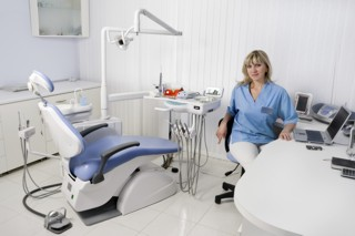 dentist office interior, female doctor sitting at the table